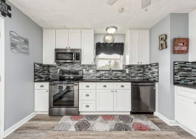 Updated cabinets, backsplash, appliances, flooring, and granite countertops.